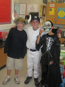 Picture of 3 students in Halloween Costume